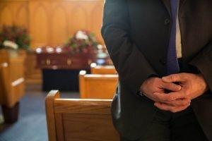 Man standing in funeral chapel