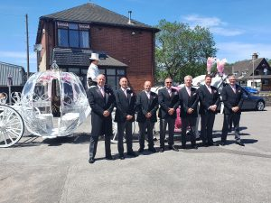 Horses with funeral director team
